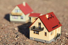 Two small models of houses. Stock Photos