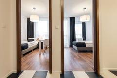 Two small, modern sleeping rooms interior design Stock Photos