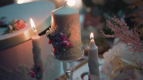 Two small and one large candle Close-up candles at the event. Beautiful light. stock video