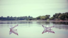 Two small paper boats floating on the water. HD 1920x1080 stock video footage
