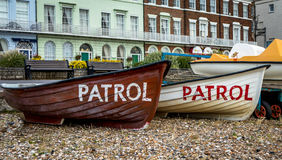 Two Small Patrol Boats on the Beach. Two small patrol boats located on the beach ready to launch when  needed for seaside rescue Royalty Free Stock Photos
