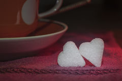 Two Small Pieces Of Sugar In The Form Of Hearts Royalty Free Stock Images