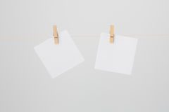Two White Notes on Wire Royalty Free Stock Images