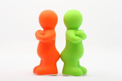 Two Small Plastic Peoples Royalty Free Stock Photos