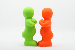 Two Small Plastic Peoples Royalty Free Stock Photography
