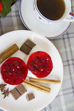 Two small raspberry cakes and cup of coffee Stock Photography