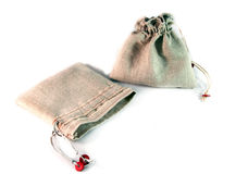 Two small sack with ties made of coarse linen cloth on white bac. Kground. Not dyed fabric, natural color Stock Photos
