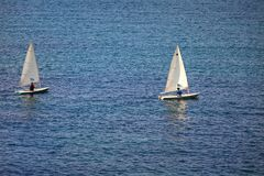 Small Sailing Boats .Isolated. Two small sailing boats in Finikas Bay in Syros Island. Stock Image stock image