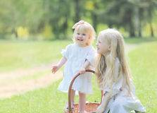 Two small sisters. Smiling and happy in a spring day Stock Image