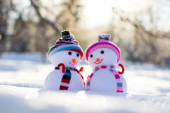 Two small snowmen in hats in park Stock Photos