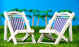 Two small sun loungers on grass Royalty Free Stock Images