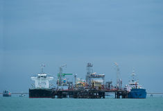 Two small tankers at an oil terminal Royalty Free Stock Photo