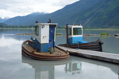 Two small tugs used for pushing rafted logs. Stock Photos