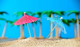 Two small umbrellas on a beach Stock Images