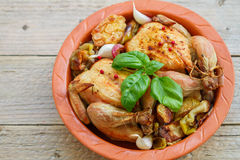 Two small whole chicken baked with onions, apples, garlic and spices Royalty Free Stock Images