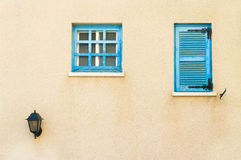 Two small windows with street light Stock Photo