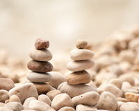 Two small zen towers on pebble beach, square Stock Photo