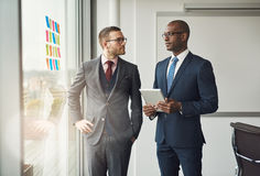 Two smart business managers in a discussion Stock Photography