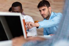 Two smart businessman using smartphone and laptop workig in office. Two smart businessman using smartphone and laptop workig in office Stock Images