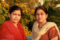Two smart Indian housewives. In an easy going and informal mood Royalty Free Stock Photo