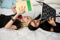 Two schoolgirls in bed Royalty Free Stock Photography