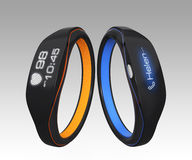 Two smart wrist band isolated on gradient background Royalty Free Stock Photography