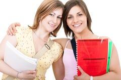 Two smiilng female student Royalty Free Stock Photos