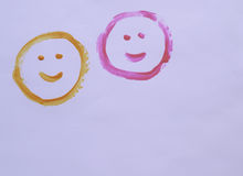 Two smiley faces. Painted onto a white background Royalty Free Stock Image