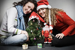 Two smiley girls celebrating christmas Royalty Free Stock Photography