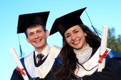 Two smiley Graduate outdoors stock photography