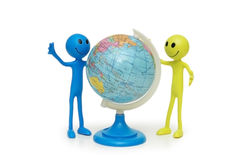 Two smilies and the globe Royalty Free Stock Photography