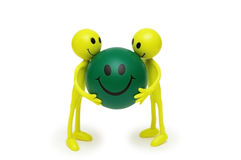 Two smilies holding ball Royalty Free Stock Photography
