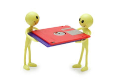 Two smilies holding floppy disks Stock Photos