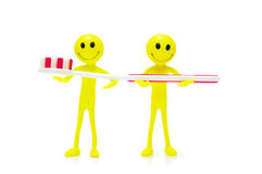 Two smilies holding toothbrush Stock Photo
