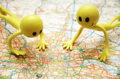 Two Smilies over the map Stock Images