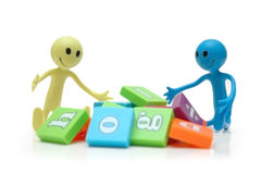 Two smilies playing with alphabet. Letters Royalty Free Stock Photography
