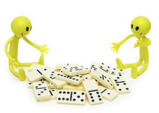 Two smilies playing with dominoes. Isolated on white stock photography