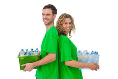 Two smiling activists holding box of recyclables and standing ba Stock Photo