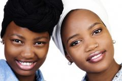 Two African American sisters with head scarfs. Two smiling attractive African American sisters double portrait with head scarfs Royalty Free Stock Photography