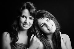 Two smiling attractive sisters. Two women hugging and smiling stock images