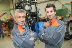 Two smiling auto mechanic workers. Mechanic royalty free stock photography