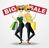 Two smiling beautiful women with big sale banners Stock Photography