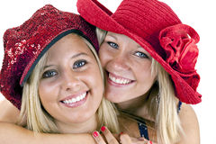 Two smiling blondes in red hats Stock Photo