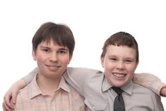 Two smiling boys. With arms on shoulders of each other, isolated on white background Stock Photos