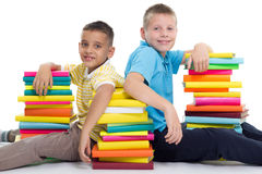 Two smiling boys with books Stock Images