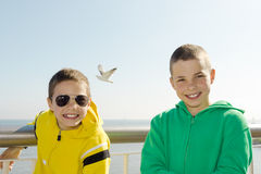 Two smiling boys on deck. Of ferry Royalty Free Stock Image