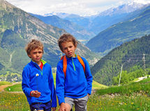 Two smiling boys in mountains Stock Image