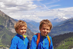 Two smiling boys in mountains Royalty Free Stock Image