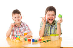 Two smiling boys painting easter eggs Stock Image