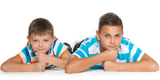 Two smiling brothers on the floor Stock Images